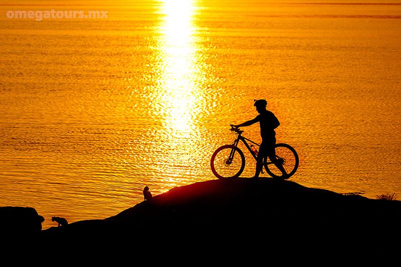 Bike tour enjoying the sunset on the beach